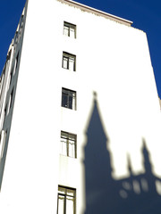 shadow of church on white building