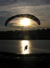 paraglider silhouette sundown
