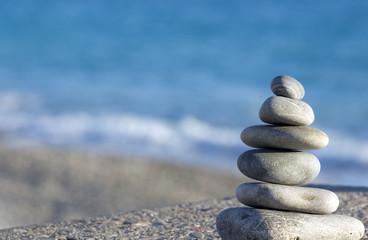 pebbles on the blue sea