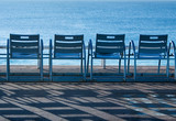 blue chairs in nice, france