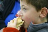 boy eating hotdog poster