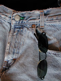 sunglasses in front pocket of blue jeans poster