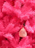 white ornament on a pink xmas tree poster