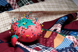 pin cushion on fabric poster