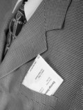 pay check in pocket of business suit poster