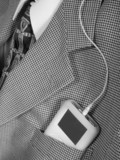 ipod in business suit pocket poster