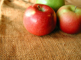 apples on a burlap bag poster
