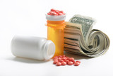 medication beside a roll of money poster