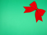 red bow at the top right with green background poster