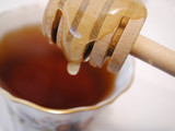 honey stick dripping honey into tea poster