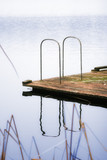 dock on a still lake poster