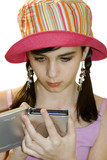 teenage girl using hand held computer poster