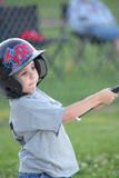 boy swinging baseball bat poster