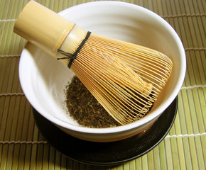 tea bowl and traditional bamboo whisk