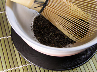 tea bowl and traditional bamboo whisk-detail