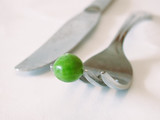 fork with pea on it poster