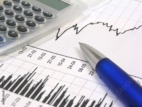 poster of stock chart with calculator and pen