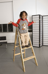 child playing on a ladder