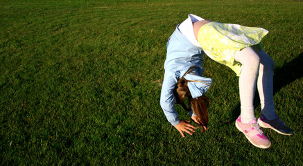 girl doing somersault