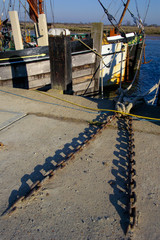 chains and old barges in maldon