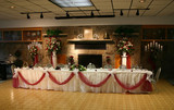 the head table at the reception of a wedding. poster