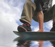 extreme skateboarder hydroplaning on water