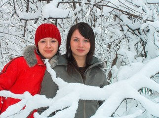 girls simply cost in a snowdrift and look in a camera