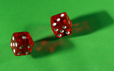 rolling red dice on green table poster