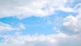 soft clouds in a blue sky poster