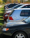 row of cars in the parking lot poster