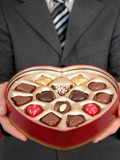 man holding heart shaped box of candy poster