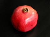 pomegranate on black background poster