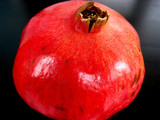pomegranate on dark background poster