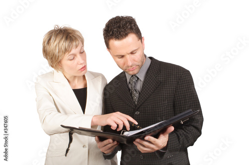 businesswoman showing report to  her partner