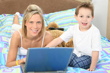 mom and son with laptop poster