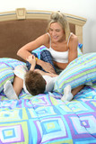 mother son tickle fight poster