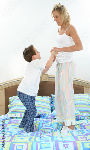 poster of mother and son playing in bed