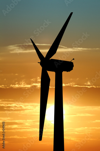 wind turbine against dramatic sky