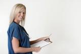 pretty nurse holding chart over white poster