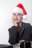 woman wearing santa hat while at work poster
