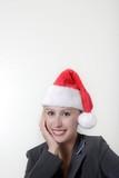pretty woman wearing santa hat poster