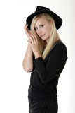 beautiful blonde woman in black hat poster