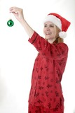 woman about to hang a christmas ornament poster