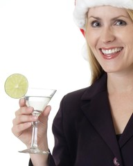 woman holding a cocktail with a lime in it