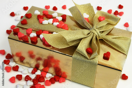 wrapped gift surrounded with heart shaped candies