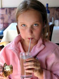 girl drinking chocolate milk in a restaurant poster