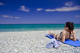 Fototapety attractive woman lying on the beach