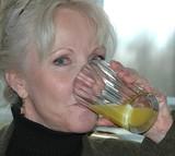 female drinking orange juice poster