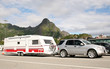 luxury car caring caravan with bikes on