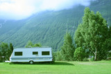 modern caravan at the campsite in the mountains poster